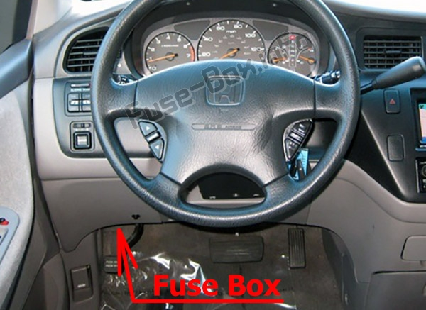 The location of the fuses in the passenger compartment: Honda Odyssey (RL1; 2000-2004)